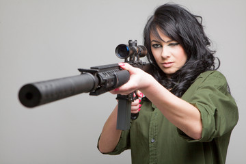 Sexy girl with machine gun