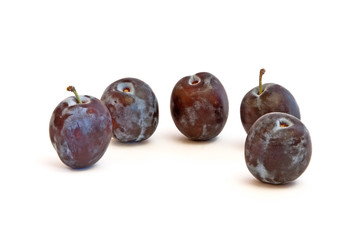 Group of plums isolated on a white