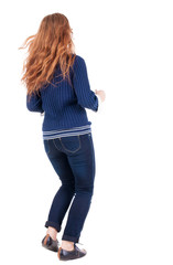 back view of jumping  woman  in  jeans