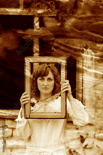 retro sepia photo European girl woman in white dress holding win