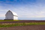 White Farm with stormy sky
