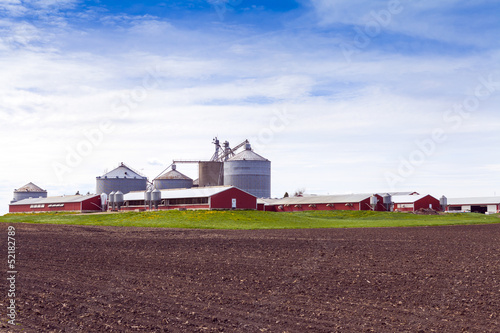Big Industrial Farm With Cloudy Sky