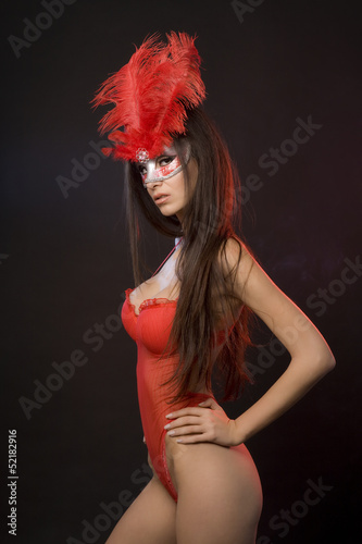Sexy woman with red lingerie and mask with feathers