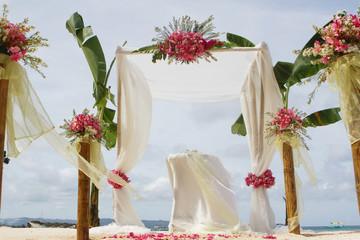beautiful wedding setup and flowers on tropical beach background