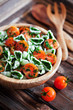 Cherry tomatoes with gluten-free pasta and spinach sauce