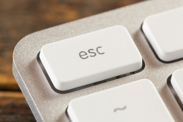 Escape Button on a White and Grey Computer Keyboard