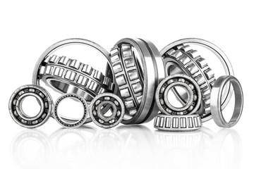 Composition of steel ball roller bearings  on white background