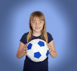 Adorable girl with a soccer ball