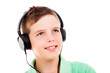 Portrait of smiling young boy listening to music on headphones a