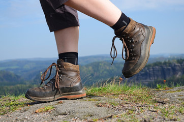 Hiking woman in trekking boots