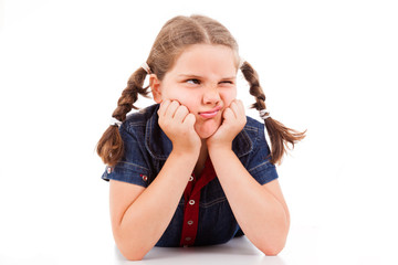 Angry little young girl child, isolated on white background