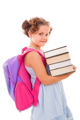 Image of schoolgirl with backpack carring books, isolated on whi