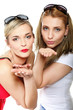 Two young women blowing kisses to the camera