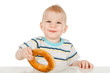 Little boy with bagel