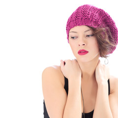 pretty serious woman wearing pink hat