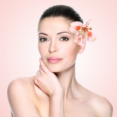 Beautiful woman with clean face and flower