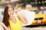 Fototapety Happy shopper holding shopping bags, New York City