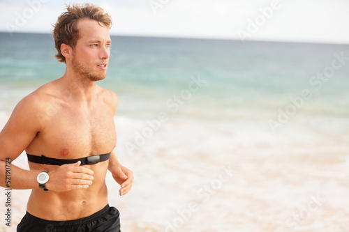 Runner man running with heart rate monitor