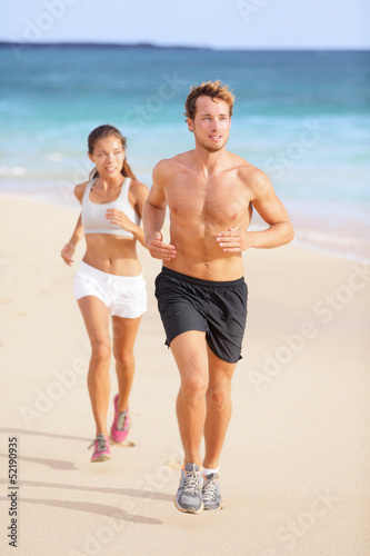 Couple running - man fitness runner first