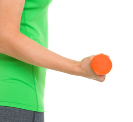 Closeup on dumbbell in hand of fitness woman
