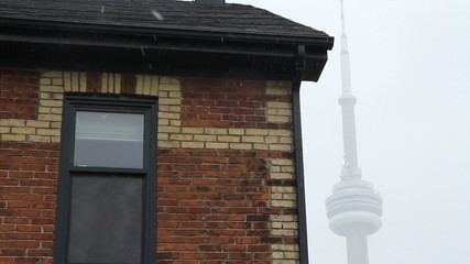 Toronto house with snow falling. Two shots.