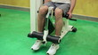 Man exercising in the gym, quadriceps working out