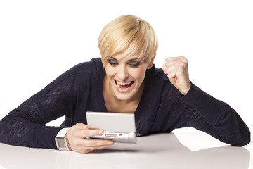 Girl with blond short hair plays on mini game computer