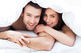 Couple under bed covers