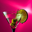 martini with lime and green olives