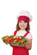 beautiful cheerful little girl cook with gourmet food