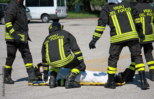 Firefighters carry a stretcher with serious injuries after the a
