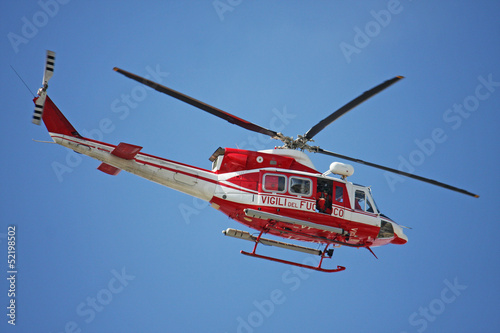 patrol helicopter of firefighters in blue sky over a fire 4