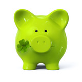 Green piggy bank with four leaf clover