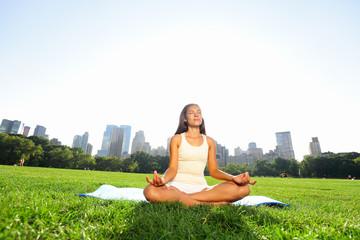 Meditating woman in meditation in New York park