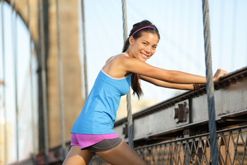 Runner stretching and running, Brooklyn, New York