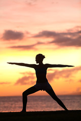Yoga woman training and meditating in warrior pose