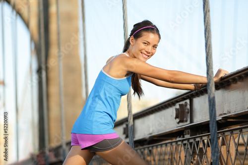Fototapeta Runner stretching and running, Brooklyn, New York