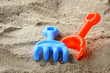 Children's beach toys on sand