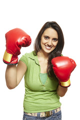 Young woman wearing boxing gloves smiling
