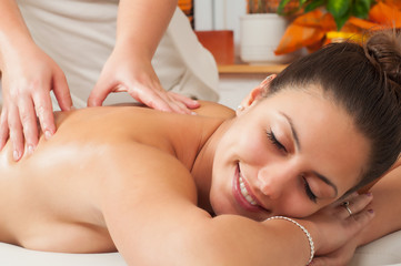 Young woman getting massage in massage salon