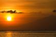 Orange sun with a golden glow - Lombok, Bali