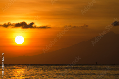 Orange sun with a golden glow - Lombok, Bali