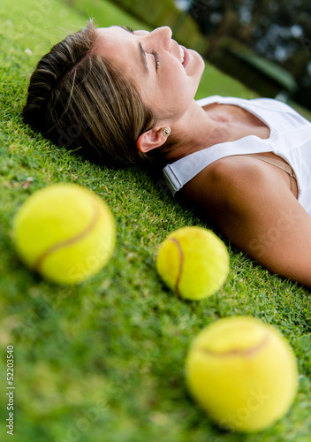 Tennis player relaxing outdoors