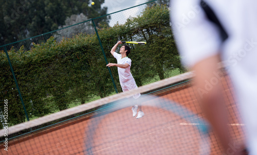 Male serving at tennis
