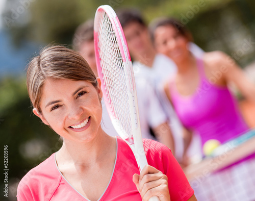 Woman at the tennis court