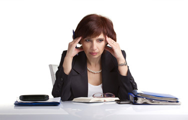 businesswoman sitting on a table and tear hair