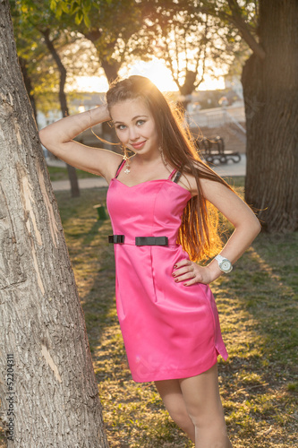 girl in backlit at sunset near tree