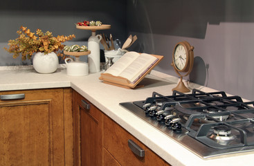 Detail of stainless burners in elegant country kitchen