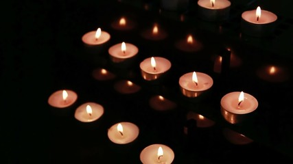 Candles at an alter being blown out