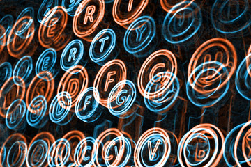 Neon typewriter keys close up